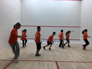 New CitySquash students warm up on court