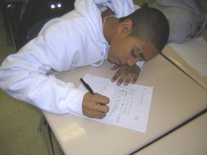 Freddy Hernandez hard at work in CitySquash's classroom