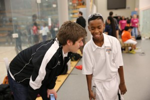 Cincinnati Squash Director Austin Schiff coaches his student