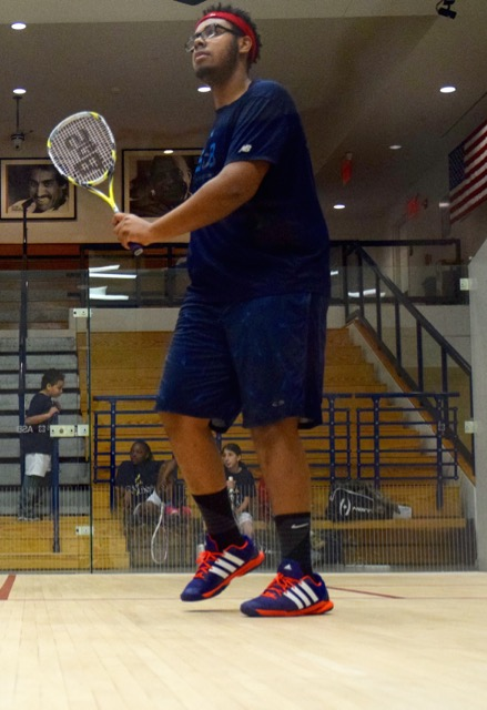 SquashBusters U17 player Mark-Anthony came out representing his program on his shirt and his strings
