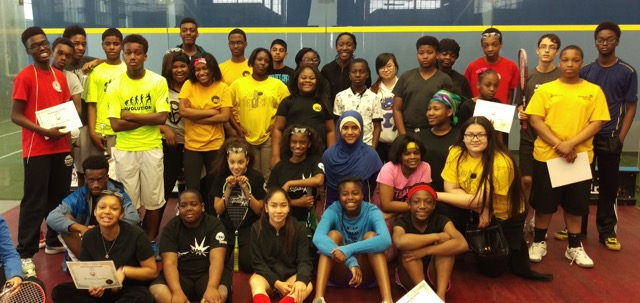 Urban Squash Toronto and Racquet Up students gather for a photo after the closing of the Canuck Classic